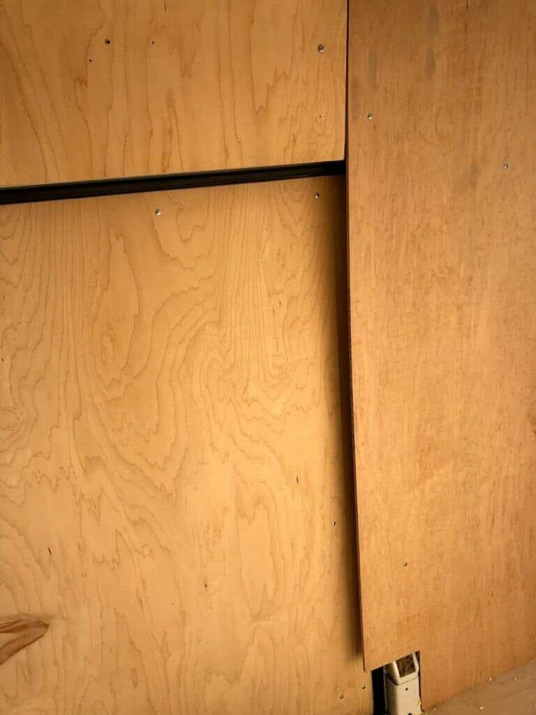 plywood van walls in a wood cabin look for vanlife