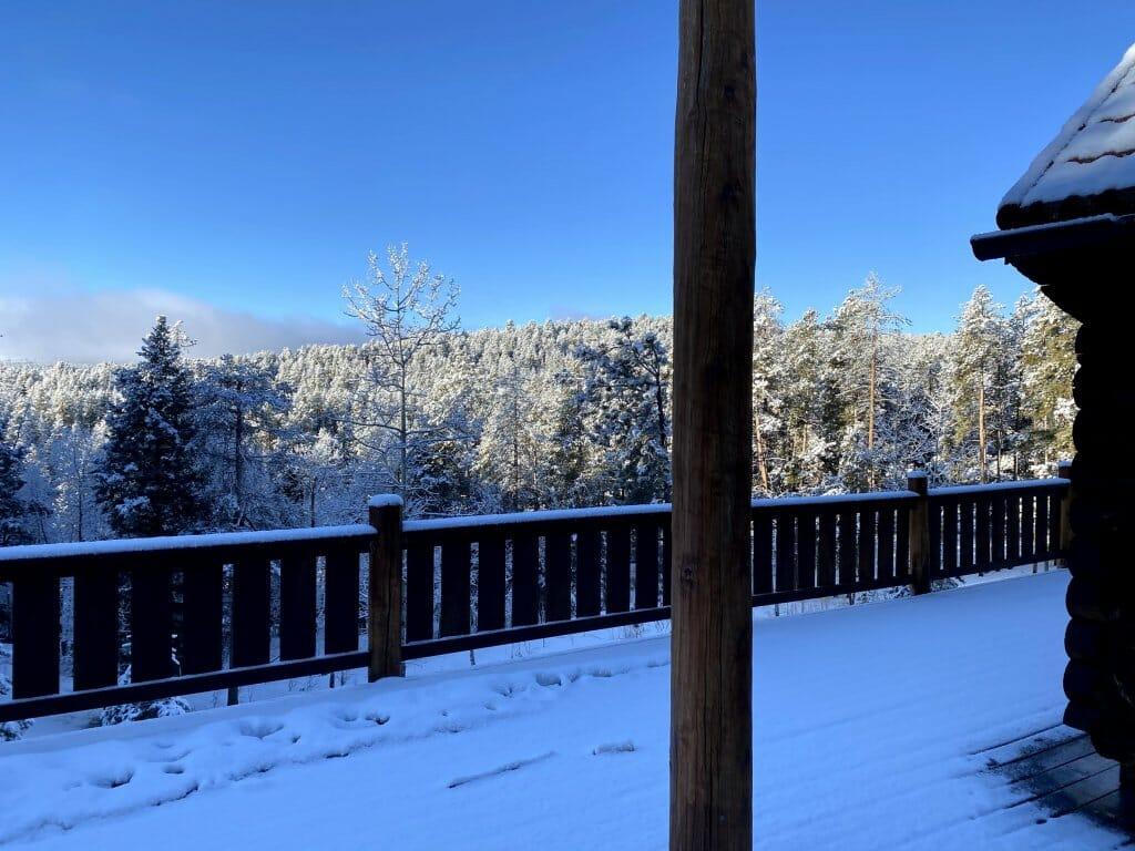 snowy cabin porch overlooking aspens in colorado